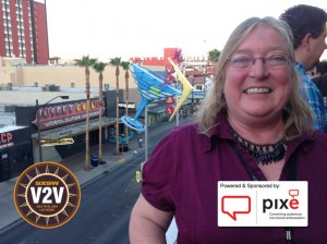Brenda on a patio overlooking Fremont Street